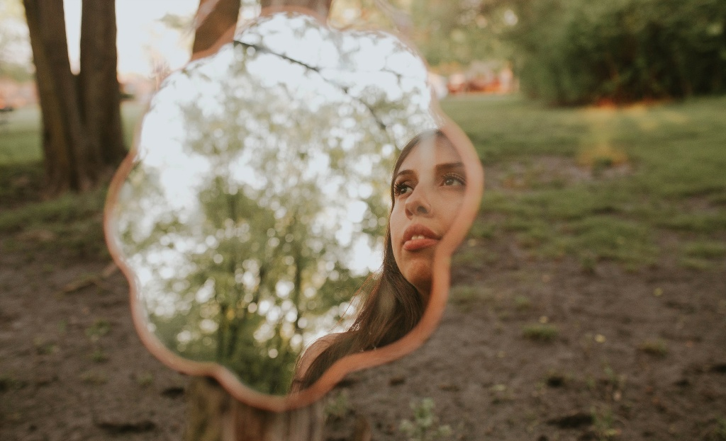 self portrait with a mirror in the woods