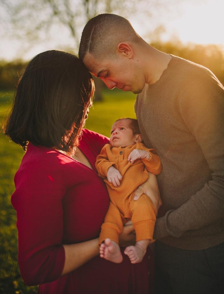 newborn baby and parents
